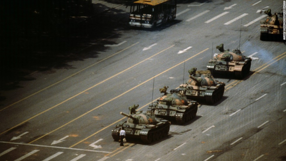 A man in Tiananmen Square stands in front of a column of T-59 tanks on June 4, 1989.