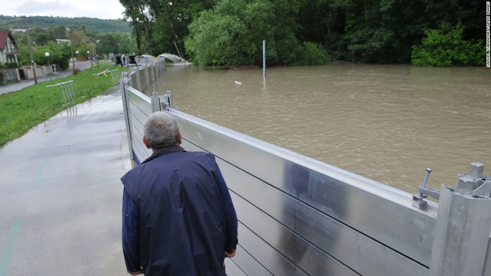A man walks near a flood protection wall in Bratislavas, Slovakia, on June 5.
