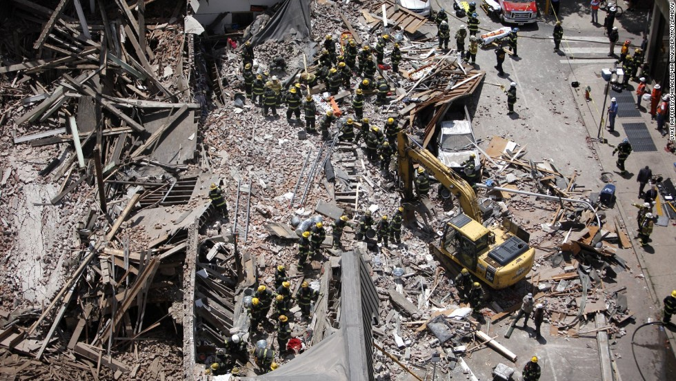 Firefighters sort through the rubble on 22nd and Market Street in Philadelphia, on June 5.
