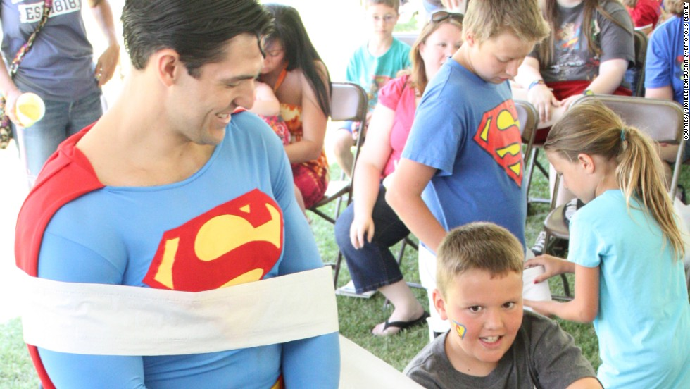 Sometimes superduties just involve spreading a little cheer. Resident Superman Josh Boultinghouse takes part in one of the free games for kids held during the Superman Celebration.