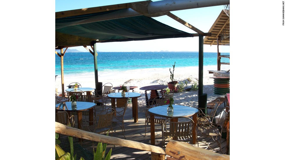 Pieced together from driftwood, wrecked racing boats and seashells and owned by a gray-bearded, grizzly reggae singer, our favorite, the Dune Preserve Beach Bar, is the kind of place you dream of discovering on your first trip to the Caribbean.