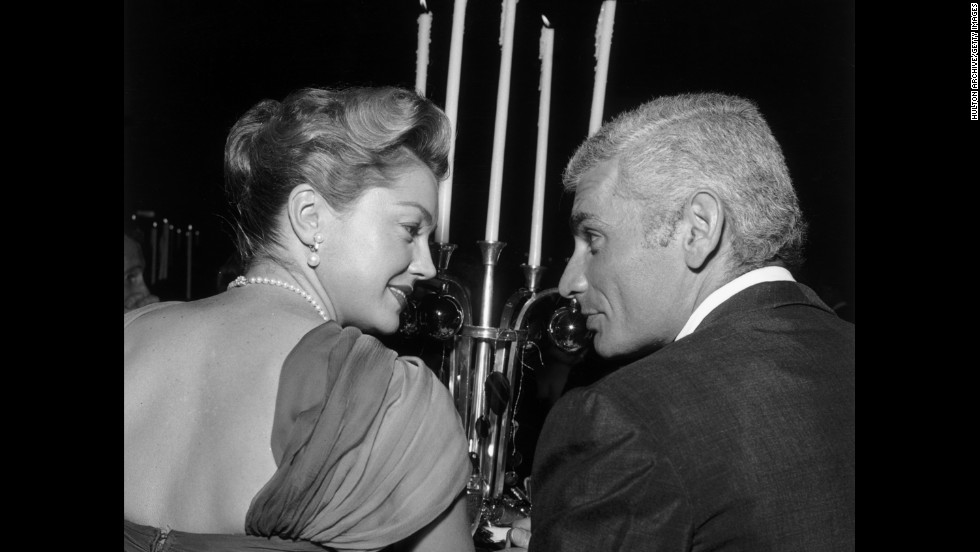 Williams and Jeff Chandler sit together during the WAIF Imperial Ball  at the Beverly Hilton Hotel in Beverly Hills, California, in November 1959.