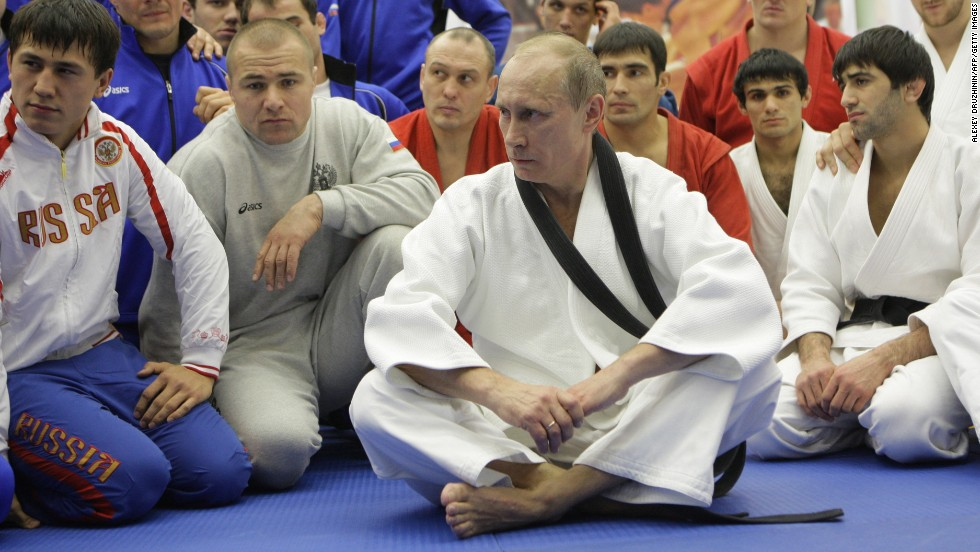 Russian president Vladimir Putin has championed sport, partly as a way of demonstrating the nation's prestige. A keen sportsman, Putin is pictured taking part in a judo training session at a sports complex in St. Petersburg in December 2010. The Russian leader holds a black belt in judo.
