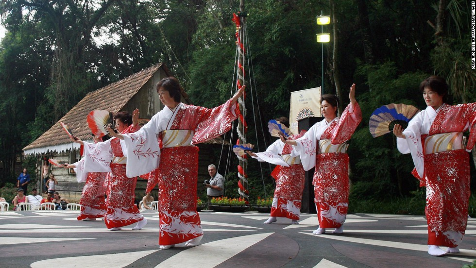 Japanese descendants perform a traditional dance during the Ethnic Dance festival in Curitiba, Brazil. The country is home to 1.8 million ethnic Japanese, the largest community outside Japan.