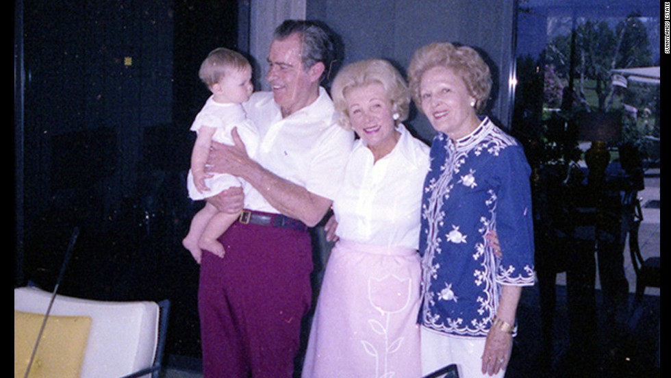 Former President Richard Nixon holds his granddaughter Jennie outside the Game Room in 1979. He's with Leonore Annenberg and wife Pat Nixon, right.