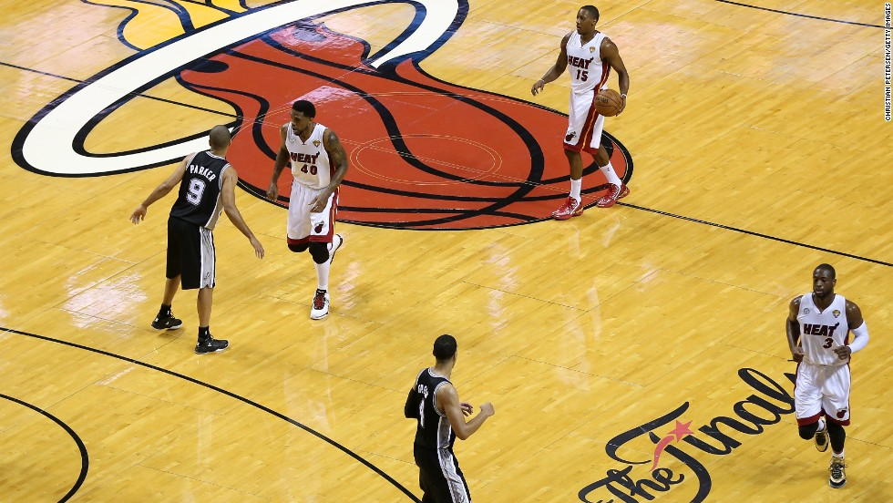 Mario Chalmers of the Miami Heat, top right, moves the ball down the court.