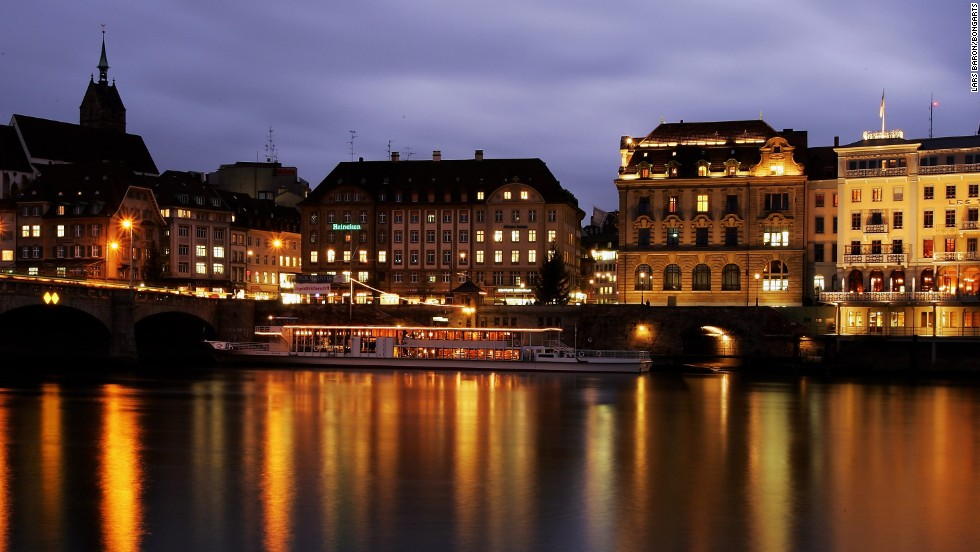 On the border with Germany, the Swiss city of Basel rose two notches to be the ninth most expensive city for expats. Here, the Old Town of Basel is seen next to the river Rhine.