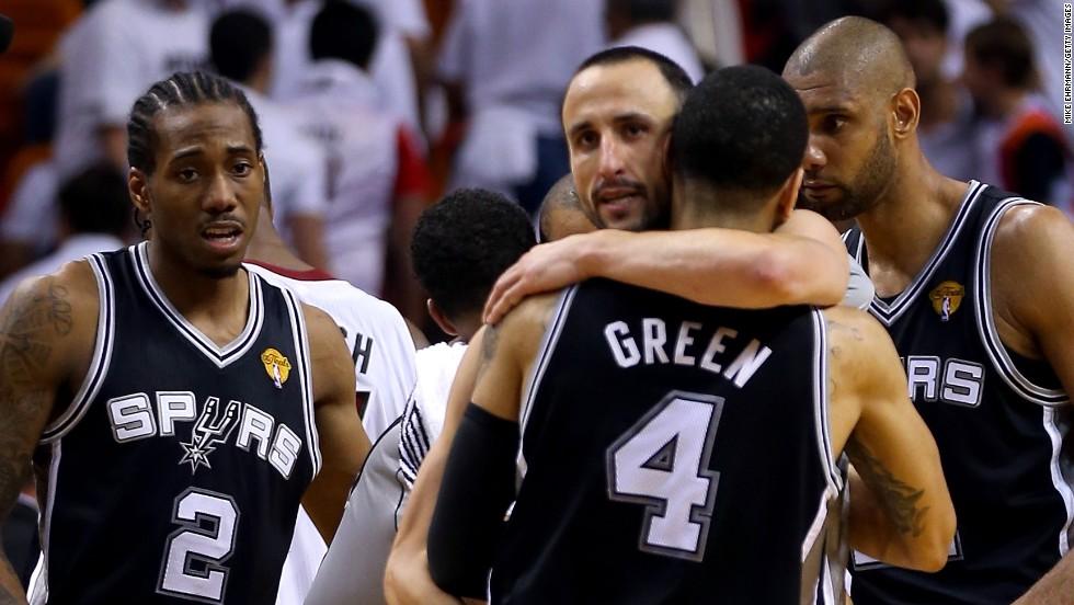 San Antonio's Manu Ginobili hugs Danny Green after their team defeated the Miami Heat.