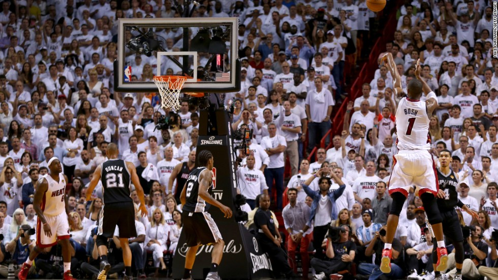 Chris Bosh of the Miami Heat misses a three-pointer with just over a minute remaining in the game.