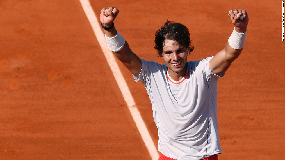 Spain's Rafael Nadal celebrates after defeating Serbia's Novak Djokovic during a French Open semifinal match in Paris on June 7. Nadal won 6-4, 3-6, 6-1, 6-7(3), 9-7.