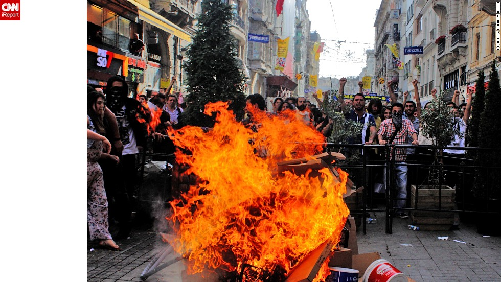 "<a href=""http://ireport.cnn.com/docs/DOC-981786"">Görkem Keser</a> captured this Fiery scene in Istanbul last Friday as protesters chant."