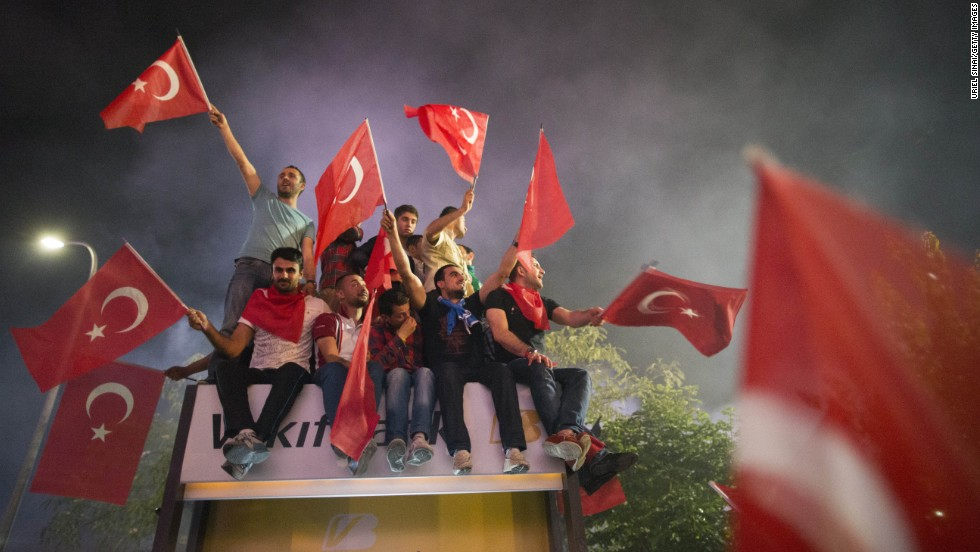 Supporters of Erdogan wave the Turkish flag upon the prime minister's arrival in Istanbul, on June 7.