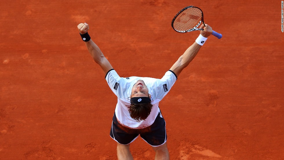 David Ferrer of Spain celebrates after defeating Jo-Wilfried Tsonga of France at the French Open at Roland Garros on Friday, June 7.  Ferrer won 6-1, 7-6(3), 6-2 . Click through to see more tennis action.