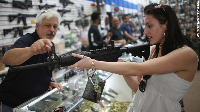 Cristiana Verro shops for guns this spring; several states have passed gun laws in the wake of the Newtown massacre.
