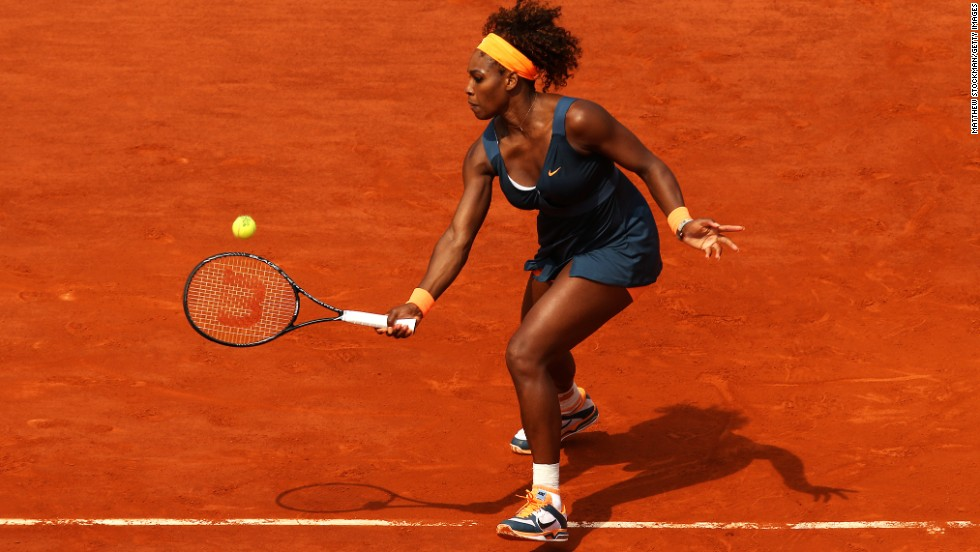 Williams plays a forehand against Sharapova.