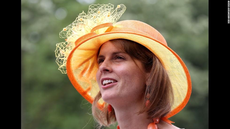 A fan in an orange hat attends the races.