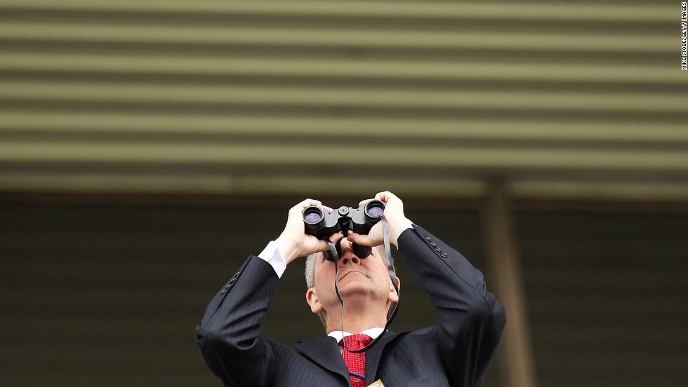 A fan looks through binoculars.