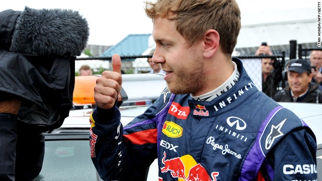 Sebastian Vettel gives his traditional thumbs up after claiming pole for the Canadian Grand Prix.