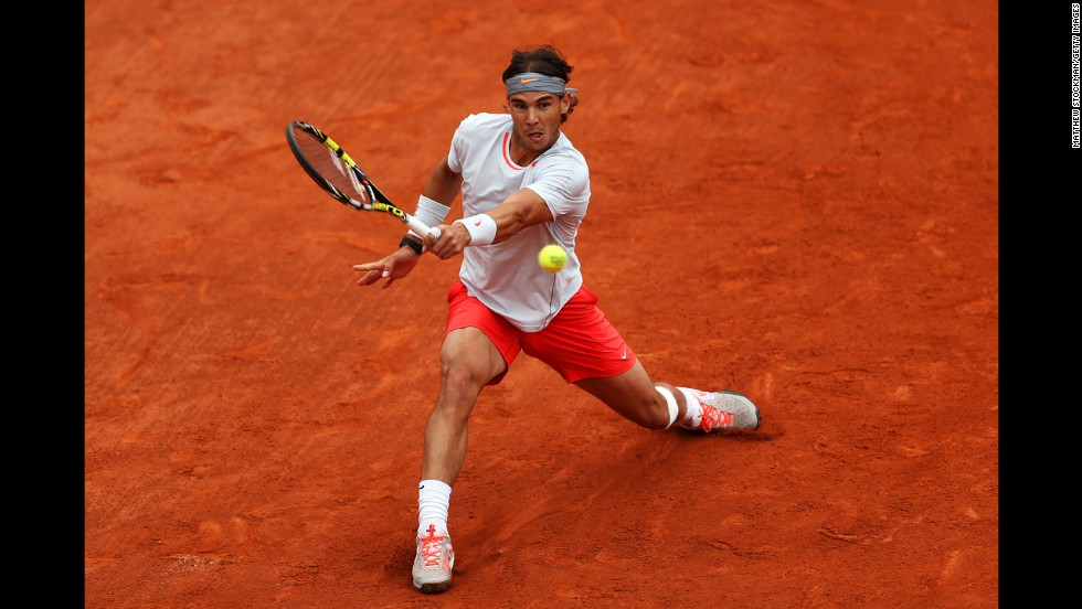 Nadal plays a backhand against Ferrer.