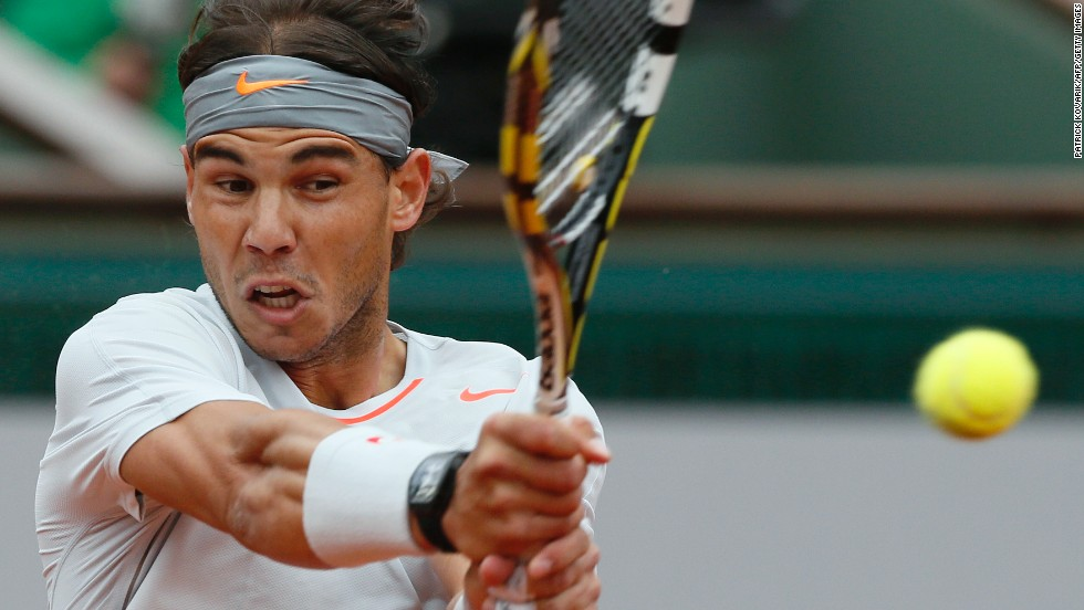 Nadal returns to Ferrer.