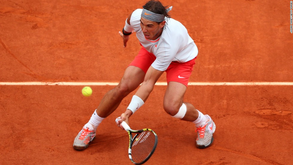 Nadal plays a forehand to Ferrer.