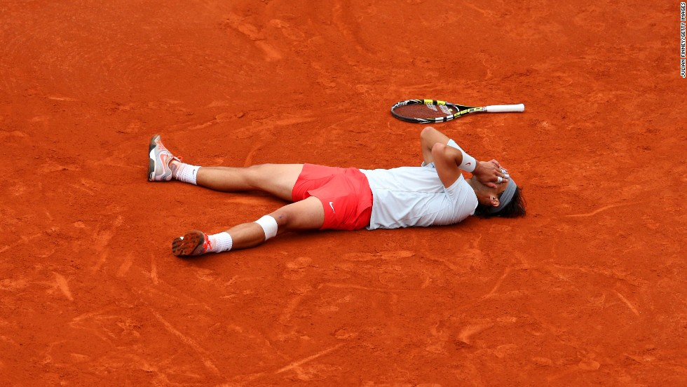 Rafael Nadal of Spain reacts after getting match point against David Ferrer of Spain during the men's singles final match of the French Open at Roland Garros Stadium in Paris, on Sunday, June 9. Nadal won 6-3, 6-2, 6-3