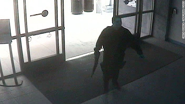 This photo, released by the Santa Monica Police department, shows the gunman entering the Santa Monica College library on June 7.  The gunman's shooting spree began in a  home near the college, where two were found dead, and ended when police killed him in the college library.