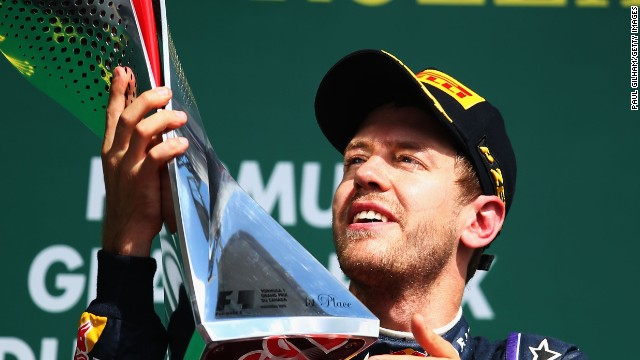 Sebastian Vettel claims the winning trophy in Montreal at last as he extends his title lead.