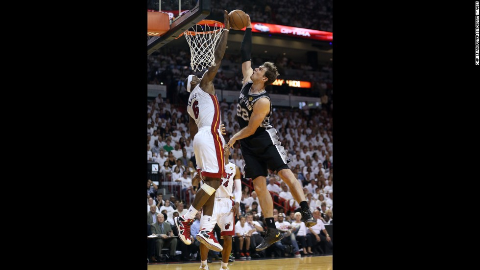 LeBron James of the Miami Heat blocks the shot of Tiago Splitter of the San Antonio Spurs in the fourth quarter.