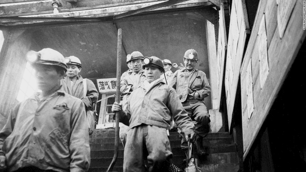 Miners descend down a mine shaft on Hashima -- the last pit closed in 1974.