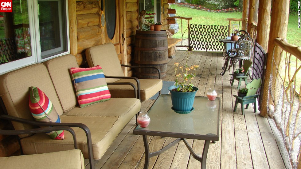 "<a href=""http://ireport.cnn.com/people/thepizzaman"">iReporter Paul Tamasi </a>says he enjoys roughly three hours each day on his rustic front porch in Belvidere, Vermont. It's part of the massive renovation he conducted on his home, turning it into a log cabin with a grand entrance."