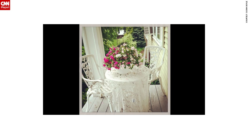 "A cozy spot for tea is how iReporter and photographer <a href=""http://ireport.cnn.com/people/suzqboyle"">Susan Boyle</a> likes to think of her small front porch. Vintage style and an air of romance -- she used colors from her wedding bouquet to dress the porch this year -- greet her as she sips her morning coffee and watches her kids walk off to school, she said."