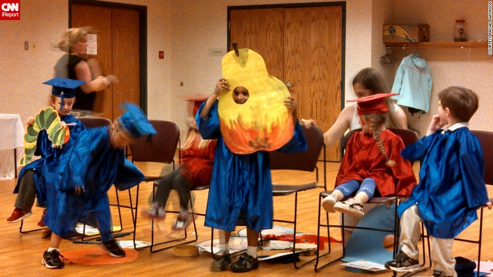 "Graduates from Creative Learning Preschool in Granby, Connecticut, performed a skit inspired by Eric Carle's ""The Very Hungry Caterpillar."" Rachel Haywood's <a href=""http://ireport.cnn.com/docs/DOC-986227"">son Riley</a> played the part of the pear. ""This is their first step into their whole lives, so to speak,"" she said of the move to kindergarten. ""They will be completely independent of their mommies and daddies for the first time."""