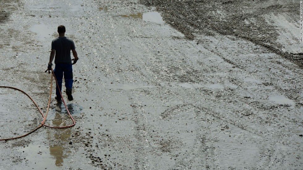 A man walks through the mud in the village of Fischerdorf near Deggendorf, southern Germany, on June 7.