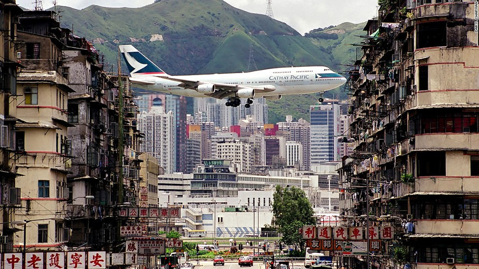 An iconic shot of Kai Tak International Airport, Hong Kong --a departing Cathay Pacific's flight captured in between the walk-up buildings in Kowloon City. The airport was replaced by Chek Lap Kok airport in 1998.
