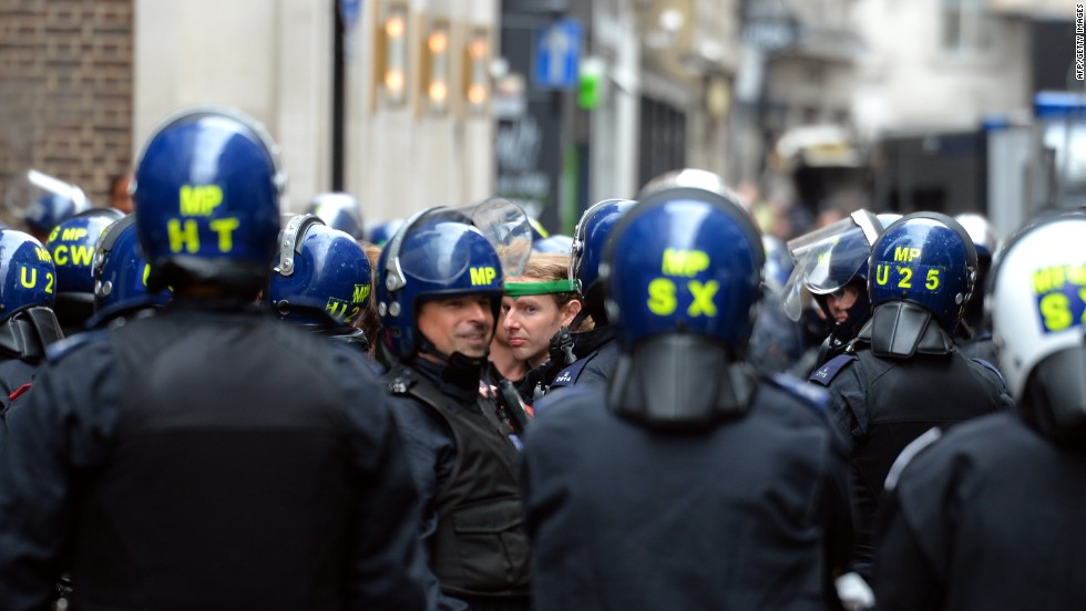 Officers move through central London on June 11.