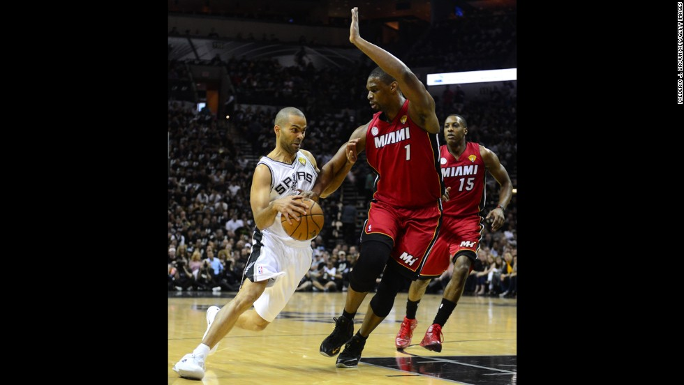 Tony Parker of the San Antonio Spurs dribbles under pressure from Chris Bosh of the Miami Heat.
