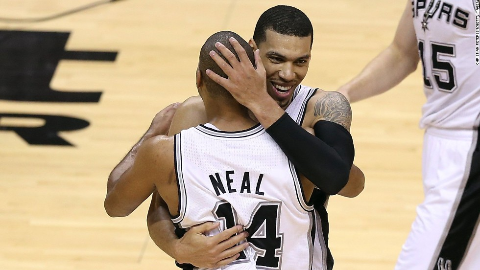 "Danny Green of the San Antonio Spurs celebrates with teammate Gary Neal as they take on the Miami Heat during Game 3 of the 2013 NBA Finals on Tuesday, June 11, in San Antonio. The Spurs defeated the Heat 113-77 and lead the series 2-1. <a href=""http://www.cnn.com/2013/06/09/us/gallery/nba-finals-game-2/index.html"">See photos from Game 2</a>."