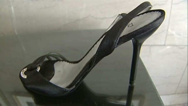 Woman charged in stiletto slaying