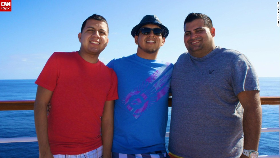 "Velez, right, was embarrassed by his size in this photo taken on the spring vacation. Though he was always known as ""the big goofy guy,"" he wanted to change into the fit guy people could come to for fitness help."