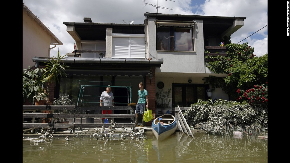 People salvage items from their house, which was flooded by the Danube River, in Dunakeszi, Hungary, on June 12.