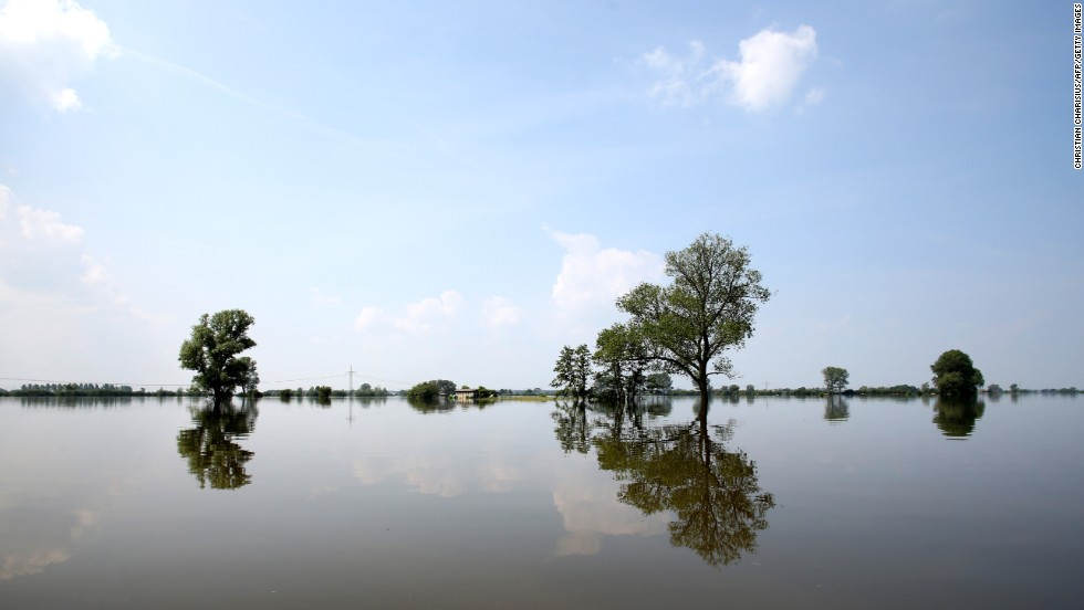 "Trees are submerged in the waters of the Elbe River in Schoenhausen, Germany, on Wednesday, June 12. Heavy rain has left rivers swollen <a href=""http://www.cnn.com/2013/06/11/world/europe/europe-flood/index.html"">across Central Europe</a>."