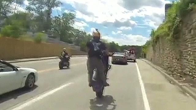 erin biker stunt hits cop car_00000803.jpg