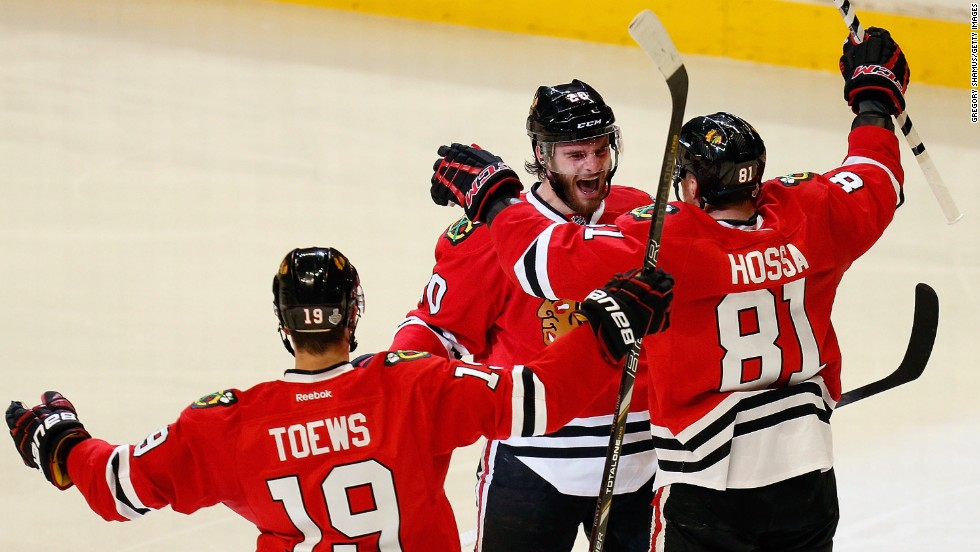 From left, Jonathan Toews, Brandon Saad and Marian Hossa of the Chicago Blackhawks celebrate after Saad scored a goal in the second period.