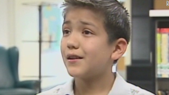 Boy sings national anthem, faces racism