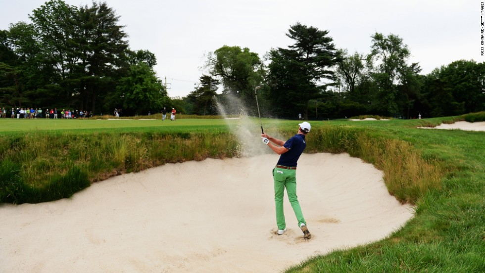 Roger Tambellini of the United States hits his second shot from a bunker on the first hole on June 13.