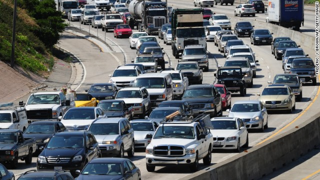 Commuters move slowly  in Los Angeles. Studies show that talking to your car's voice technology impairs driving.