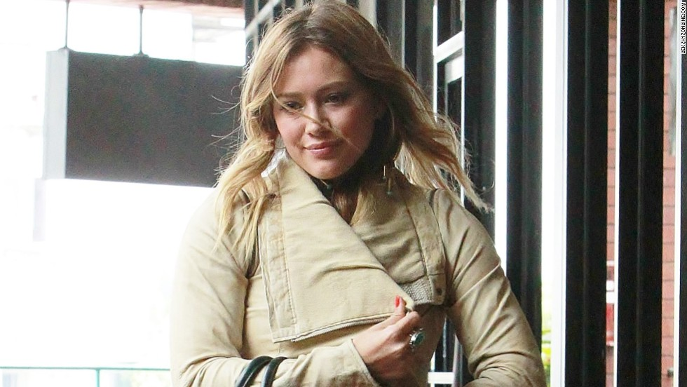 Hilary Duff runs errands in white leather jacket in Los Angeles.