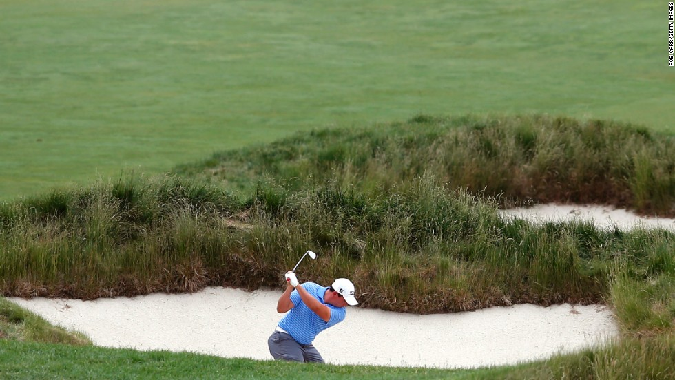 Scott Stallings of the U.S. shoots from a bunker on the 15th hole on June 13.