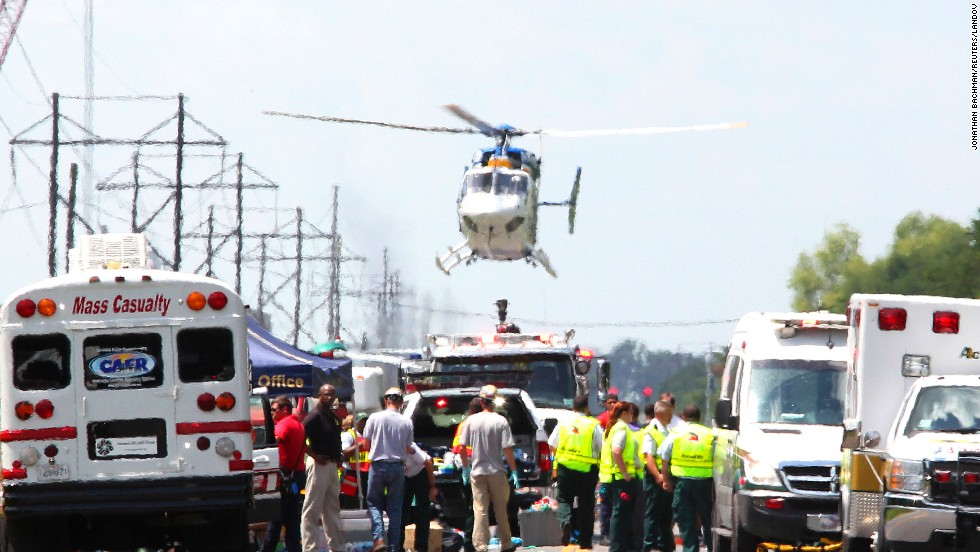 A medevac helicopter lands at a triage center set up near the chemical plant.